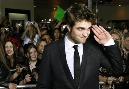 Actor Robert Pattinson, star of the new film ''The Twilight Saga: New Moon'' poses at the film's Los Angeles premiere November 16, 2009. REUTERS/Fred Prouser