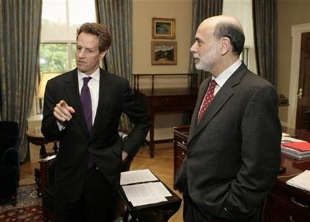Treasury Secretary Timothy Geithner talks to Federal Reserve Chairman Ben Bernanke before a meeting at the Treasury Department, May 7, 2009. REUTERS/Yuri Gripas