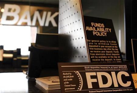 Signs explaining Federal Deposit Insurance Corporation (FDIC) and other banking policies are shown on the counter of a bank in Westminster, Colorado November 3, 2009. REUTERS/Rick Wilking
