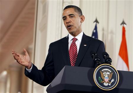 President Barack Obama speaks during a joint news conference with Prime Minister of India Manmohan Singh in the East Room at the White House in Washington November 24, 2009. REUTERS/Larry Downing