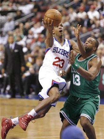 Philadelphia 76ers guard Lou Wiliams (L) drives on the Boston Celtics forward Shelden Williams (13) during the fourth quarter of NBA basketball action in Philadelphia, Pennsylvania November 3, 2009. REUTERS/Tim Shaffer
