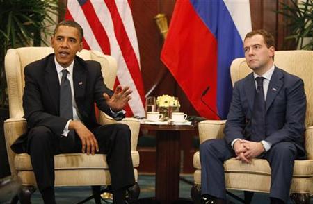 U.S. President Barack Obama speaks alongside Russian President Dmitry Medvedev during their bilateral meeting in Singapore November 15, 2009. REUTERS/Jason Reed