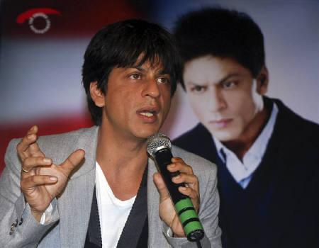 Bollywood star Shahrukh Khan speaks with the media at a news conference in Mumbai August 6, 2009. REUTERS/Manav Manglani/Files
