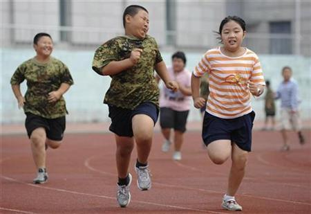 Children exercise during a weight-loss summer camp in Shenyang, Liaoning province, August 3, 2009. REUTERS/Sheng Li
