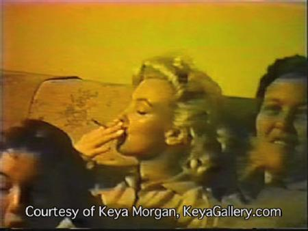 A screegrab from a home movie shows Marilyn Monroe apparently smoking marijuana. The movie is dates to 1958 or 1959, based on her appearance. REUTERS/Keya Morgan/Handout