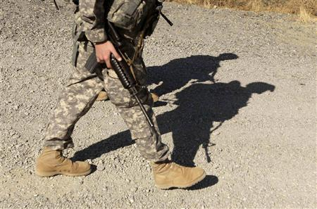 U.S. soldiers from Task Force TF Yukon walk to a transport helicopter at FOB Salerno, Afghanistan, December 2, 2009.REUTERS/Zohra Bensemra