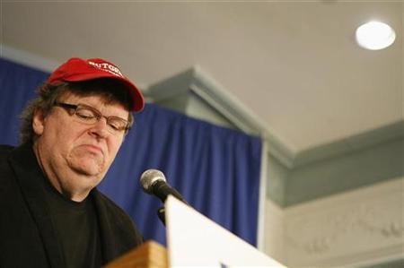 Filmmaker Michael Moore speaks at a news conference ''to challenge President Obama and the Democrats to stand strong on healthcare reform that includes a public option,'' in Washington September 29, 2009. REUTERS/Molly Riley