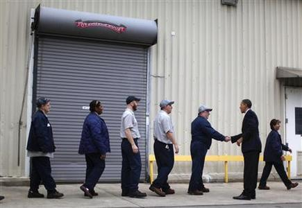 President Barack Obama greets workers during a shift change at the Nestle Purina Pet Care plant in Allentown, Pennsylvania December 4, 2009. REUTERS/Jim Young