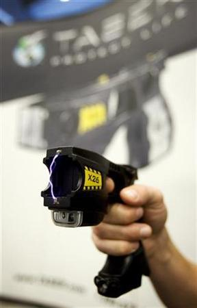 A taser X26 model is demonstrated at a trade show for the Canadian Association of Chiefs of Police in Montreal August 26, 2008. REUTERS/Christinne Muschi