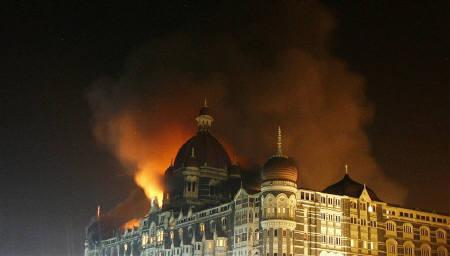 Smoke rises from the Taj Hotel in Mumbai in this November 27, 2008 file photo. A major attack on India by Islamist militants could lead to retaliation by a country still bruised by last year's assault on Mumbai, further destabilising nuclear-armed Pakistan. REUTERS/Arko Datta/Files