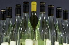 <p>Bottles of Australian produced wine are seen on a shelf in Sydney May 15, 2006. REUTERS/Will Burgess</p>