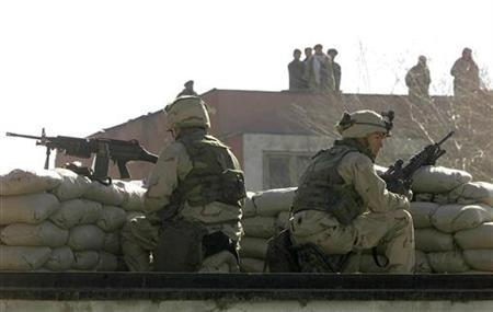 Two U.S. marines secure the U.S. embassy in Kabul on January 17, 2002. REUTERS/Oleg Popov
