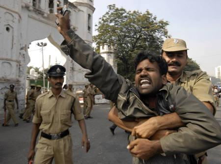 Policemen detain a protester in Hyderabad December 9, 2009. Violent protests by students for a separate state to be carved out of the Andhra Pradesh shut down the main city of Hyderabad on Wednesday. REUTERS/Krishnendu Halder