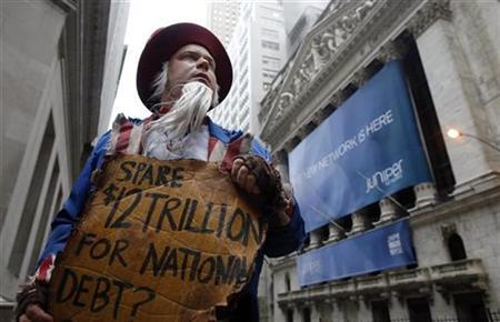 James Bowers, dressed as Uncle Sam, asks people if they can ''spare a trillion'', as they walk past him in the rain outside the front of Federal Hall, near the New York Stock Exchange, October 28, 2009. REUTERS/Chip East