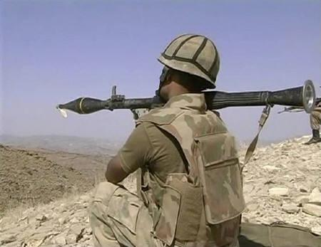 A Pakistani soldier aims his RPG during a battle between Pakistani security forces and Taliban in the South Waziristan region in this image taken from a video grab released by the Pakistani military on October 21, 2009. REUTERS/Pakistan Government/Handout via Reuters TV/Files