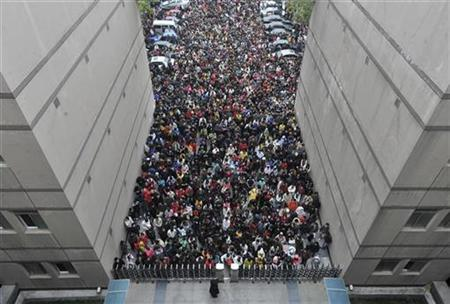 Applicants wait outside a university to take part in a nationwide civil service entrance exam in Wuhan, Hubei province November 29, 2009. More than one million applicants are expected to participate in the examination, Xinhua News Agency reported. Only 15,000 positions are available. REUTERS/China Daily