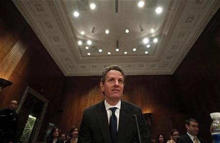 Treasury Secretary Timothy Geithner arrives to testify at a hearing before a Congressional Oversight Panel overseeing the expenditure of the Troubled Asset Relief Program (TARP) on Capitol Hill in Washington, December 10, 2009. REUTERS/Jim Young