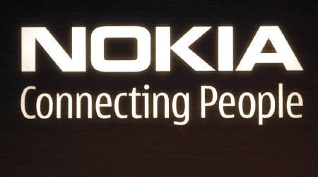 The corporate logo hangs on a wall at Nokia world headquarters in Helsinki in this July 9, 2008 file photo. German firm IPCom said on Friday a German court has decided the world's top cellphone maker, Nokia, and Taiwan's HTC are infringing two patents held by IPCom. REUTERS/Bob Strong/Files