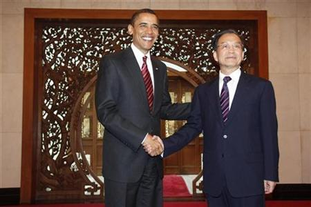 U.S. President Barack Obama (L) shakes hands with Chinese Premier Wen Jiabao prior to their talks at the Diaoyutai State Guest House in Beijing November 18, 2009. REUTERS/David Gray