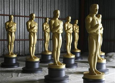 Large Oscar statues are seen before getting a fresh coat of paint by scenic artists near Los Angeles October 19, 2009, in preparation for the Academy of Motion Picture Arts & Sciences Governors Awards in November 2009 and the 82nd Academy Awards in March 2010. REUTERS/Fred Prouser