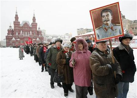 Russian communists stand in line in Red square to attend a wreath laying ceremony at the tomb of Soviet dictator Josef Stalin marking the 130th anniversary of his birthday at the Kremlin wall in Moscow, December 21, 2009. REUTERS/Sergei Karpukhin