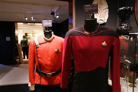 Uniforms used as a props from the television series ''Star Trek'' sit on display during a preview of the auction ''40 Years of Star Trek: The Collection'' at Christie's auction house in New York, September 29, 2006. REUTERS/Keith Bedford