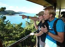 "<p>Winner of ""The Best Job in the World"" competition Ben Southall (R) of Britain and his girlfriend Breanna Watkins pose in their house on Hamilton Island, about 950km (590 miles) north of Brisbane, July 1, 2009. REUTERS/Queensland Tourism/Eddie Safarik/Handout</p>"