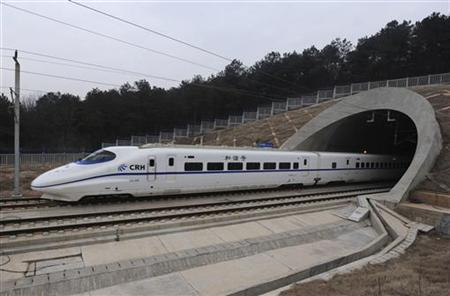 A high-speed train travels on the new Wuhan-Guangzhou railway in Wuhan, Hubei province, December 26, 2009. REUTERS/Stringer