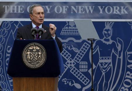 Mayor Michael Bloomberg addresses the crowd after taking the Oath of Office during his inauguration at New York's City Hall, January 1, 2010. REUTERS/Jessica Rinaldi