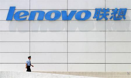 A Chinese security guard walks under a huge company logo of the Lenovo headquater in China's financial center Shanghai August 10, 2005. Lenovo Group Ltd is unveiling a new look for its classic ThinkPad line, and is including Advanced Micro Devices Inc microprocessors in the laptops for the first time. REUTERS/STR/Files