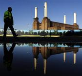<p>A worker is seen reflected in water as he passes near Battersea Power Station in west London in this December 4, 2009 file photo. As debt-laden developers face the ruins of recent extravagance, the Power Station -- Europe's largest brick building -- is a decrepit symbol of the past profligacy and present pain in Britain's real estate market. Picture taken December 4, 2009.</p>