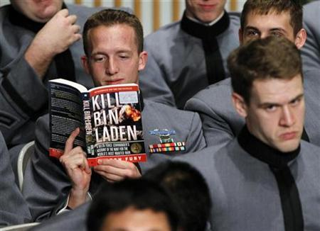 A U.S. Army cadet reads a book entitled ''Kill Bin Laden'' as he waits with other cadets for President Obama to deliver an address on U.S. policy and the war in Afghanistan at the U.S. Military Academy in West Point, December 1, 2009. REUTERS/Shannon Stapleton