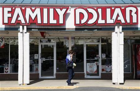 A woman walks by the Family Dollar store in Arvada, Colorado in this October 7, 2009 file photo. REUTERS/Rick Wilking