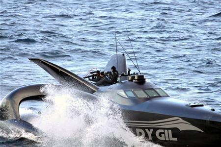 Activists from the Sea Shepherd Conservation Society on their high-tech powerboat Ady Gil sails near a Japanese whaling fleet in the Southern Ocean January 6, 2010. REUTERS/The Institute of Cetacean Research/Handout