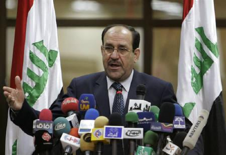 Iraq's Prime Minister Nuri al-Maliki talks to the media during a visit to Basra, 420 km (260 miles) southeast of Baghdad, September 10, 2009. REUTERS/Atef Hassan/Files