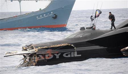 The damaged powerboat Ady Gil, which belongs to the Sea Shepherd Conservation Society, floats near the Japanese ship Shonan Maru No. 2 after a collision between the two vessels in the Southern Ocean January 6, 2010. REUTERS/Sea Shepherd/JoAnne McArthur/Handout