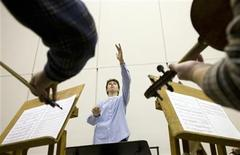 "<p>Prodigy conductor and composer Alexander Prior, 15, rehearses with the New Opera Orchestra one day before performing his ballet ""Jungle Book: Mowgli"" in the Kremlin in Moscow, February 2, 2008. REUTERS/Thomas Peter</p>"
