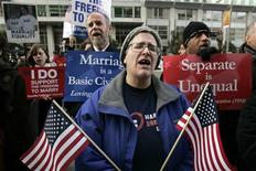 <p>Marilee Kreml sings with a group of same-sex marriage supporters outside the federal courthouse in San Francisco, California January 11, 2010. California's ban on gay marriage went to trial in a federal case that plaintiffs hope to take all the way to the U.S. Supreme Court and overturn bans throughout the nation. REUTERS/Robert Galbraith</p>