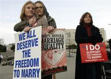 <p>Same-sex couple Elizabeth Chase (L) and Kate Baldridge stand outside the federal courthouse in San Francisco, California January 11, 2010. REUTERS/Robert Galbraith</p>