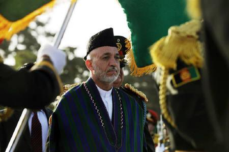 Afghan President Hamid Karzai returns from inspecting the guard of honor during Independence Day celebrations at the Defence Ministry compound in Kabul in this August 19, 2009 file photo. REUTERS/Massoud Hossaini/Pool/Files