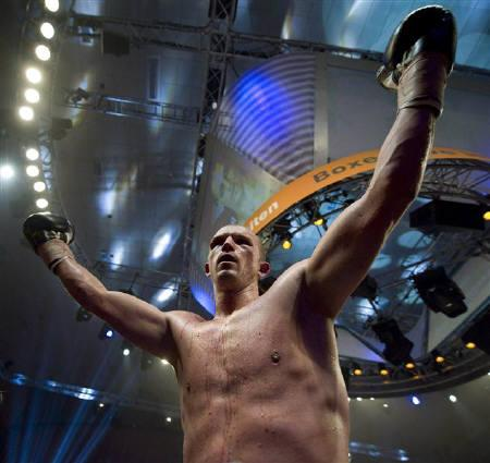 German boxer Juergen Braehmer celebrates after defeating Dmitry Sukhotsky of Russia during thier 12-round WBO cruiserweight title fight in the northern German city of Schwerin December 19, 2009.  REUTERS/Morris Mac Matzen/Files