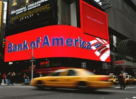 A taxi speeds past a Bank of America branch in New York's Times Square January 11, 2008. REUTERS/Brendan McDermid