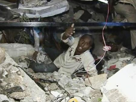 A man calls for help while being trapped at the Port-au-Prince University, after a major earthquake struck, in Port-au-Prince in this January 13, 2010 video grab. REUTERS/Reuters TV