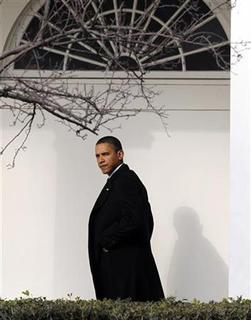 President Barack Obama walks at the White House in Washington January 12, 2010. REUTERS/Larry Downing