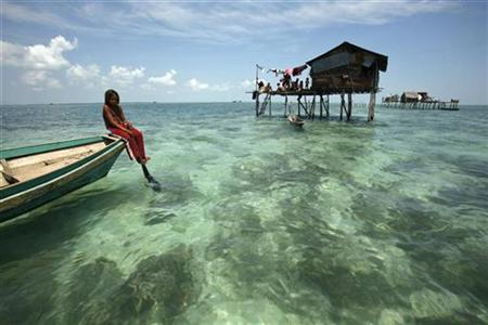A Bajau Laut girl basks on her boat in her neighbourhood in Sulawesi Sea in the Malaysia's state of Sabah on the Borneo island February 17, 2009. REUTERS/Bazuki Muhammad