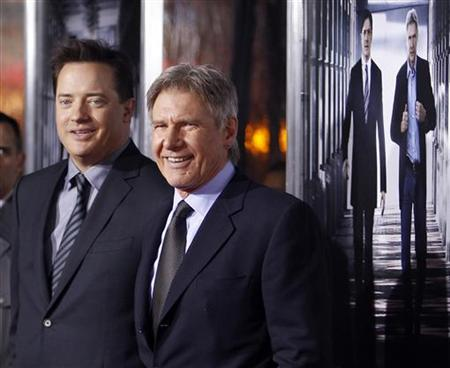 Cast members Brendan Fraser (L) and Harrison Ford pose together at the premiere of CBS film's ''Extraordinary Measures'' at Grauman's Chinese Theatre in Hollywood, California, January 19, 2010. REUTERS/Danny Moloshok
