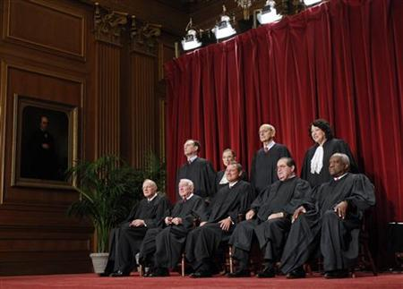 Supreme Court Justices gather for an official picture at the Supreme Court, September 29, 2009. REUTERS/Jim Young