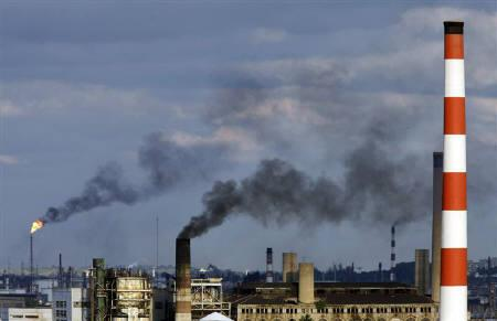 Smoke rises from chimneys at an electric plant in Havana in this November 2009 file photo. REUTERS/Enrique De La Osa