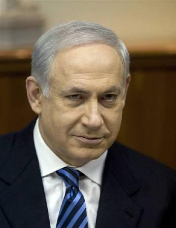 Israel's Prime Minister Benjamin Netanyahu attends the weekly cabinet meeting in Jerusalem January 24, 2010. Netanyahu said on Thursday an Israeli army field hospital that treated earthquake victims in Haiti had given Israel an image boost, after allegations of war crimes in the Gaza conflict.  REUTERS/Dan Balilty/Pool/Files