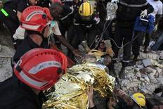 <p>Soccorritori al lavoro ad Haiti REUTERS/St Felix Evens</p>